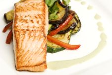 Salmon With Eggplant Peppers With Spinach Sauce Royalty Free Stock Photos