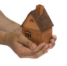 Free Small House In A Hand Royalty Free Stock Photography - 9787777