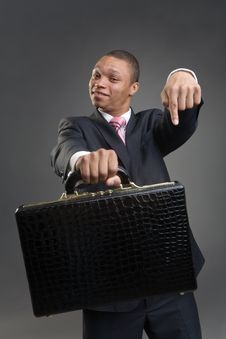 Free Businessman Offers Briefcase Stock Images - 9789984