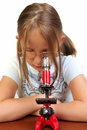 Free Girl Studying Something With Microscope Royalty Free Stock Photography - 9791757