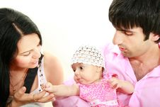 Happy Family With Baby Daughter Stock Photo
