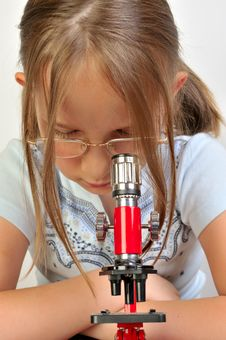 Free Girl Studying Something With Microscope Stock Photos - 9791763