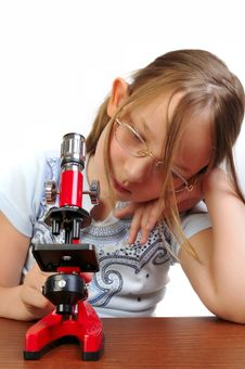 Free Girl Studying Something With Microscope Stock Photo - 9791780