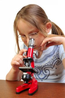 Free Girl Studying Something With Microscope Stock Photos - 9791783