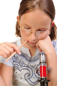 Free Girl Studying Something With Microscope Royalty Free Stock Photos - 9791798