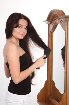The Girl Combs Hair Royalty Free Stock Photos