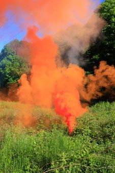 Free Orange Smoke On A Glade Stock Photography - 9794792