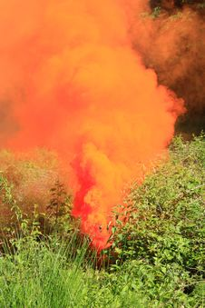 Orange Smoke On A Green Grass Stock Photo