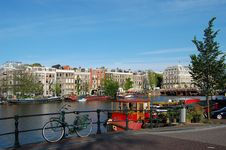 Free Old  Canal Houses In Amsterdam With A Bike Royalty Free Stock Photo - 9794905