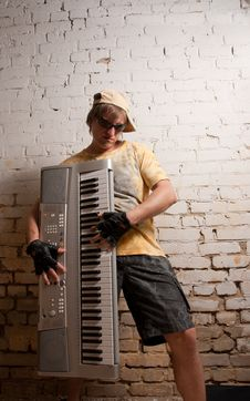 Portrait Of Musician With Synthesizer Stock Image