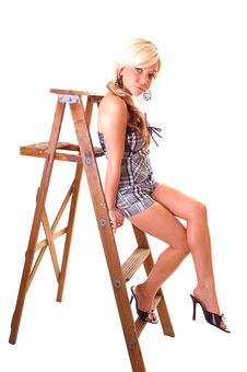 Girl On Stepladder. Royalty Free Stock Photos