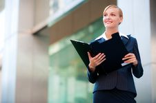 Free A Beautiful Businesswoman Holding A Clipboard Royalty Free Stock Photography - 9799867