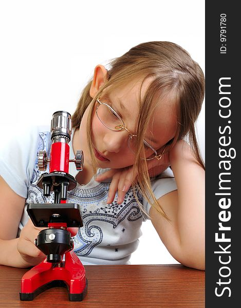 Girl studying something with microscope