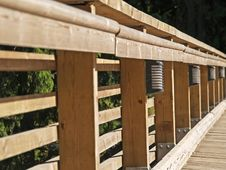 Free The Wooden Rail Of The Bridge Royalty Free Stock Photo - 987795