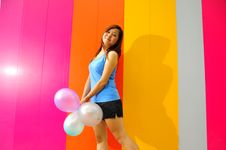 Free Young Asian Woman Holding Balloons Royalty Free Stock Photos - 9800998