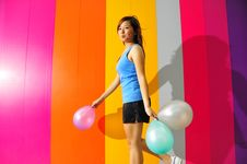 Free Young Asian Woman Holding Balloons Royalty Free Stock Images - 9801029