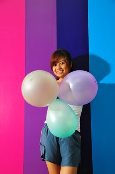 Free Young Asian Woman Holding Balloons Royalty Free Stock Photography - 9801047