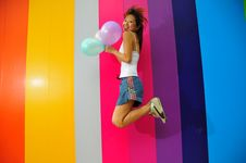 Free Young Asian Woman Holding Balloons Royalty Free Stock Photo - 9801065