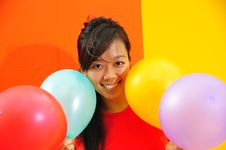 Free Young Asian Woman Holding Balloons Stock Photos - 9801103