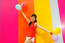 Free Young Asian Woman Holding Balloons Stock Photo - 9801120