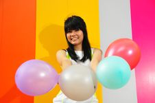 Free Young Asian Woman Holding Balloons Stock Photos - 9801133