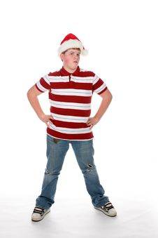 Free Annoyed Looking Teenage Boy In Santa Hat Stock Photos - 9804713