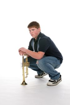 Free Teenage Boy Leaning On His Upright Trumpet Royalty Free Stock Photo - 9804725