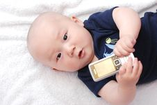 Free Cute Baby With Cellphone Stock Image - 9805741