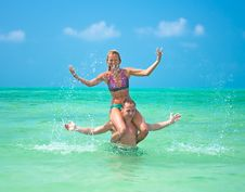 Free Couple Are  Cracking And  Having Fun In  Water Royalty Free Stock Photos - 9805928