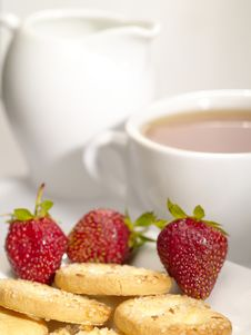 Tea Cup With Cookies And Berry Stock Photo