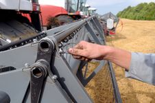 Free Man S Hand Reapiring Harvester Stock Photos - 9808053