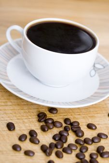 Free Cup Of Coffee And Coffee Beans Stock Photography - 9808242