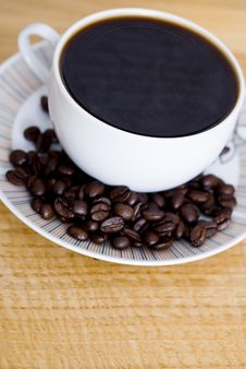 Free Cup Of Coffee And Coffee Beans Stock Photo - 9808280