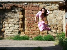 Free Girl Jumping On Grunge Background Royalty Free Stock Image - 9809116