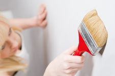 Girl With Paint Brush Royalty Free Stock Photos