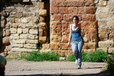 Free Teen Girl Walking On Grunge Background Royalty Free Stock Photography - 9809367