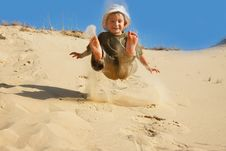Free Boy Jumping In Sands Royalty Free Stock Photography - 9809537