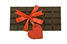 Free Black Chocolate With Red Ribbon And Tag Stock Photos - 9811573