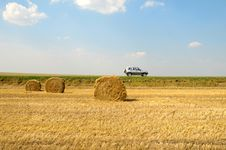 Free Field With Three Rolls Of Straw Stock Image - 9812491