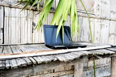 Free Laptop On A Bamboo Table Stock Photography - 9813142