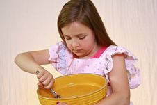 Free Young Cute Girl With Pink Apron And Mixing Bowl. Royalty Free Stock Image - 9813196