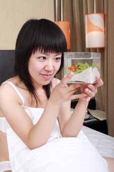 Free Asian Girl With Her Goldfish Royalty Free Stock Photography - 9814007