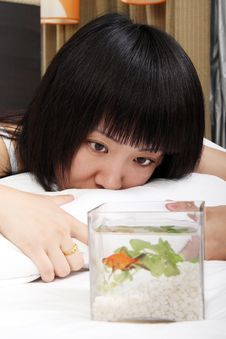 Asian Girl With Her Goldfish Royalty Free Stock Photos
