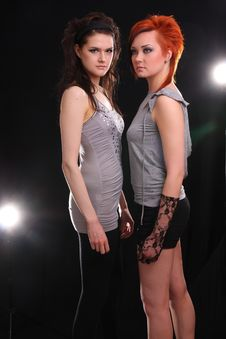 Free Two Models In Colorful Setting In The Studio Stock Photo - 9817420