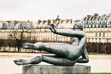 Lying Woman In Tuileries Royalty Free Stock Photo