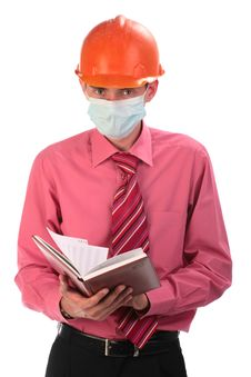 Free The Engineer In A Helmet And A Mask Stock Images - 9823734