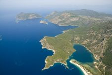 Free Paragliding Over Olu Deniz Royalty Free Stock Images - 9824339
