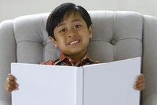 Free Boy Reading A Book Royalty Free Stock Photo - 9824505