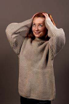 Free Smiling Red Haired Woman In Sweater Royalty Free Stock Images - 9825179