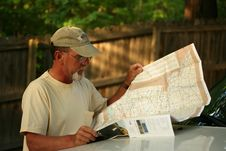 Free Mature Adult Man Looking At Map Stock Images - 9826014